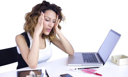 Woman with headache at the desk